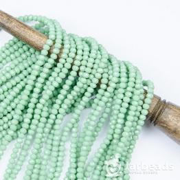 Кристаллы рондель 3*4мм зеленый нежный керамика 140штук арт.42